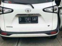Toyota Sienta type V kilometer 13000 warna putih bulan juni