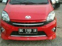 Toyota Agya TRD merah 2012 pakean pribadi