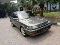 Toyota Corolla E80 1991 abu-abu